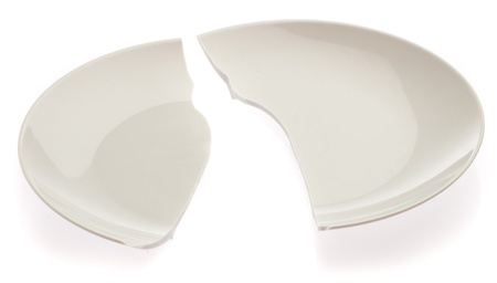 kitchen ware: broken plate isolated on a white background Stock Photo