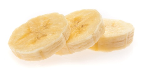 sliced fruit: banana slices isolated on a white background