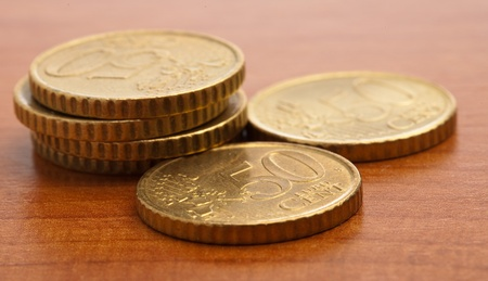 euro cent coin closeup on a wooden surface photo