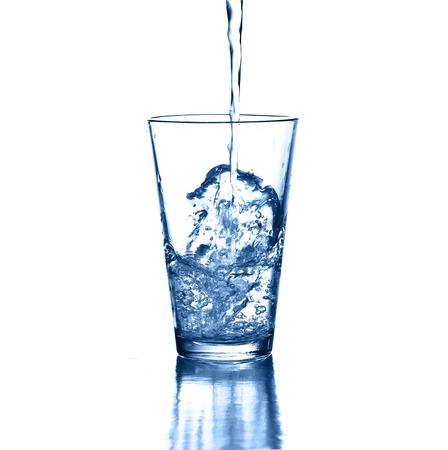quench: puring fresh water on glass on white background Stock Photo