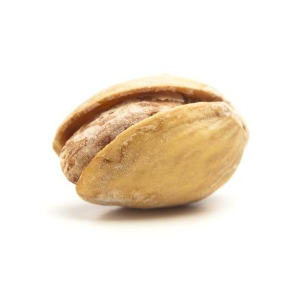 single pistachio isolated on a white background photo