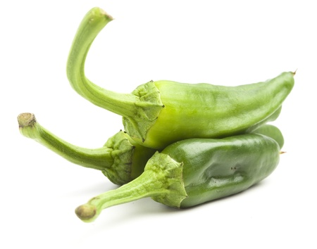 spicy chilli: green peppers pile isolated on a white background Stock Photo