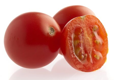 cherry tomatoes sliced on a white background Stock Photo - 8771717