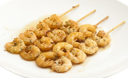 shrimp with garlic on a plate, closeup photo photo