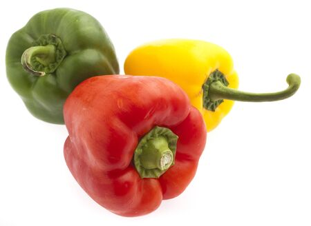 red, yellow and green pepper on white photo