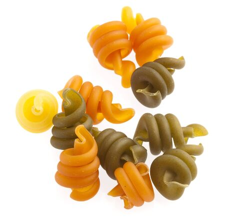 uncooked pasta spirals isolated on a white background photo