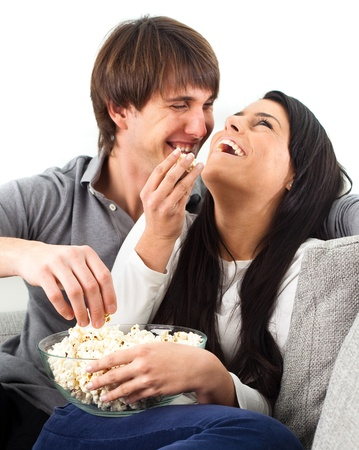 couple watching a film on white background Stock Photo - 8849701