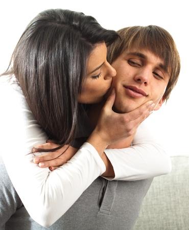 couple, girl kissing her boyfriend, closeup Stock Photo - 8849693