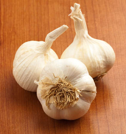 garlic on a wooden surface, closeup photo photo