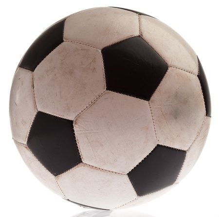 dirty soccer ball isolated on a white background photo