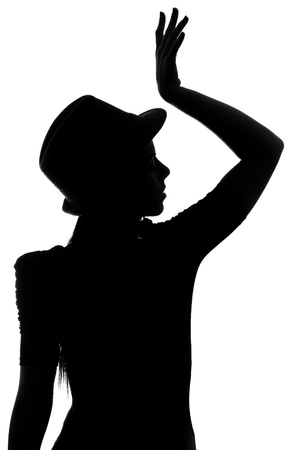 girl with hat silhouette on a white background photo