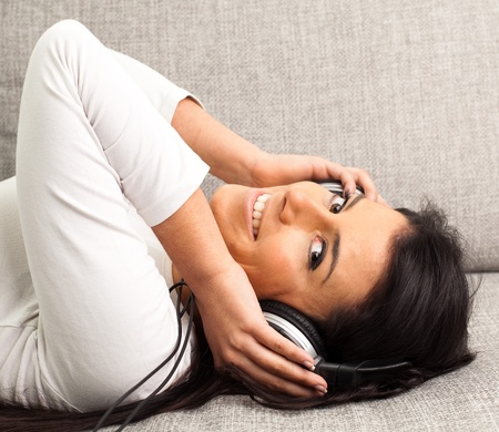 girl listening to music on the sofa Stock Photo - 8849999