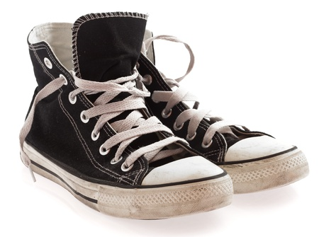 dirty old man: black sneakers isolated on a white background Stock Photo
