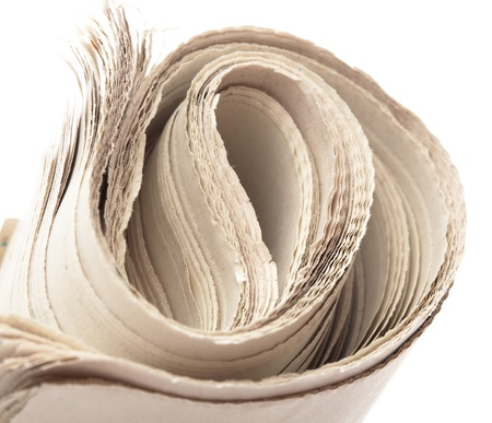 folded newspaper on a white background, closeup Stock Photo - 8849977