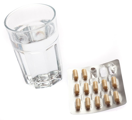 pills and water glass on a white background photo