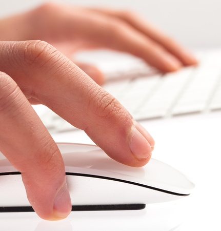 man typing with keyboard on a white background photo