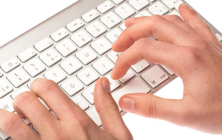 man typing on a keyboard on white background photo