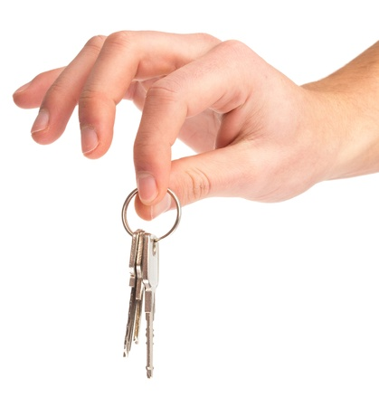 hand holding keys on a white background Stock Photo