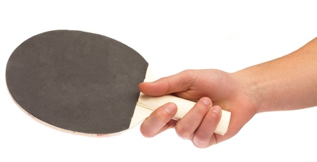 hand holding a ping pong racket on white photo