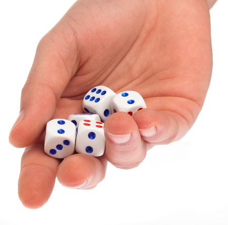 dices on a hand on a white background photo