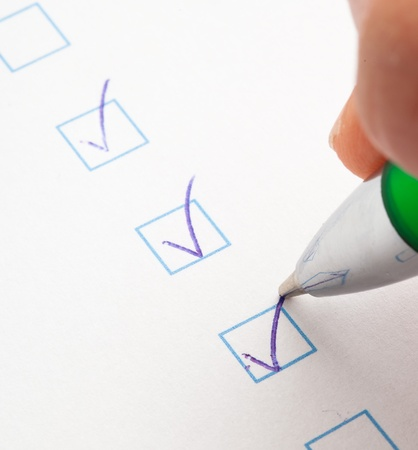 voting paper: check box of questionnaire, extreme closeup photo Stock Photo