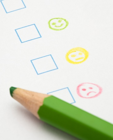 marketing research: questionnaire check boxes smile, extreme closeup photo