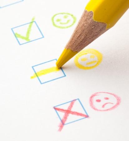 tickbox: questionnaire check boxes smile, extreme closeup photo