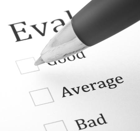 pen quality: quality questionnaire and pen, extreme closeup photo