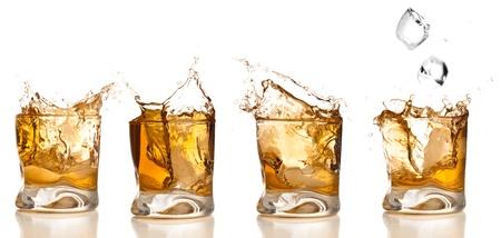 whiskey: whisky splash collectie geïsoleerd op een witte achtergrond Stockfoto