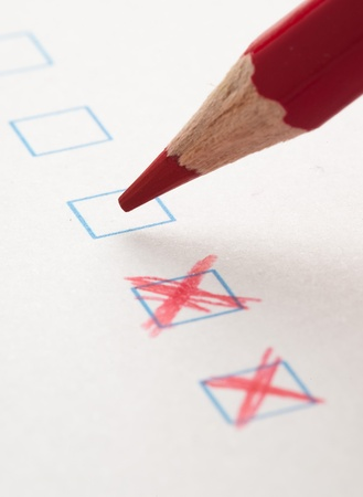 test check box and red crayons, closeup photo Stock Photo - 9874293
