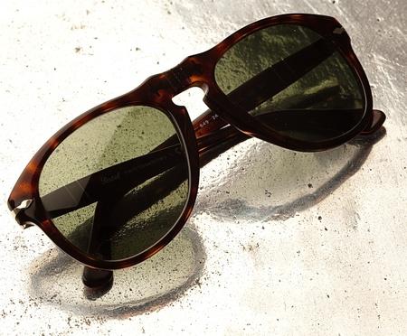 vintage sunglasses on  ametal surface photo