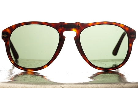 modern sunglasses on a metal surface photo
