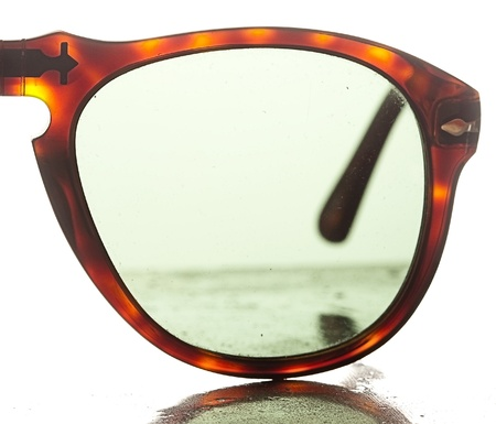 modern sunglasses on a metal surface photo