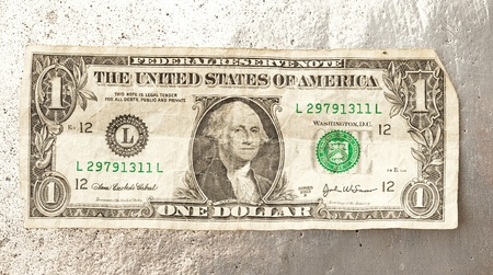 one dollar bill: one dollar on a metal surface