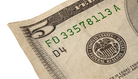 5 dollar note on a white background photo