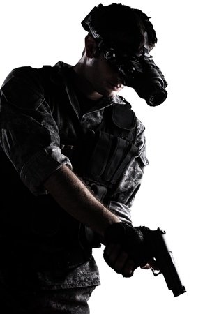 soldier wearing urban camouflage uniform with night vision goggles and a gun on white background photo