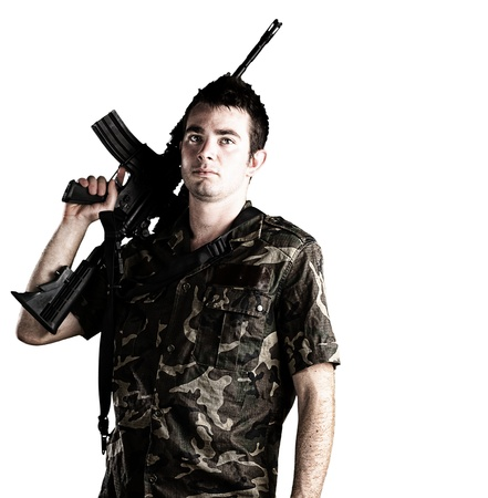 us air force: young soldier holding a rifle on a white background