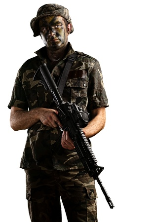 man holding gun: young soldier with jungle camouflage on a white background