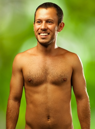 man shirtless on a nature background photo