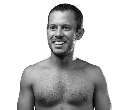 man shirtless, black and white background photo