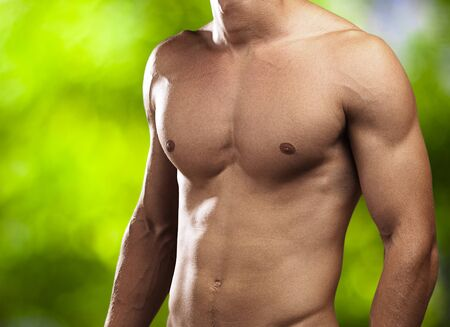 perfect torso of a young man at park photo