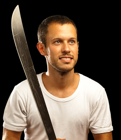 man with sword on a black background photo