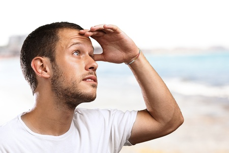 looking ahead: man looking forward to the future in the beach Stock Photo