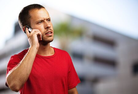 young businessman calling on mobile phone at city Stock Photo - 10384128