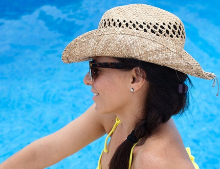 woman in a pool with a straw hat Stock Photo - 10384093