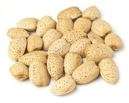shelled: shelled almonds stack on a white background Stock Photo