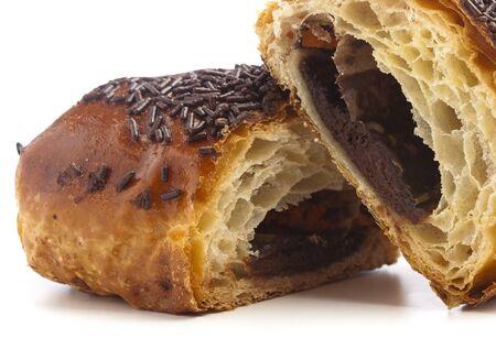 cream puff: chocolate bun closeup on a white background
