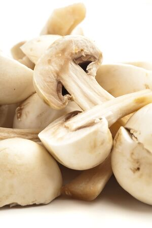 button mushrooms slices on a white background Stock Photo - 10364414