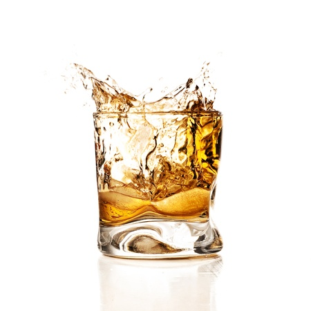 whiskey glass: whisky splash against a white background