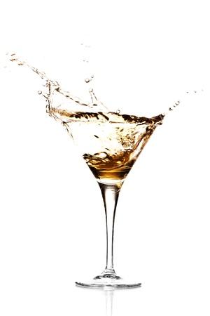 brown cocktail splash against a white background photo